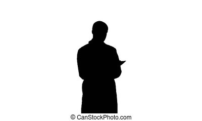 Silhouette Male doctor in white coat filling in prescription...