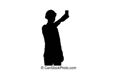 Silhouette Construction worker using phone to take selfies....