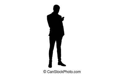 Silhouette Businessman using mobile phone. Professional shot...