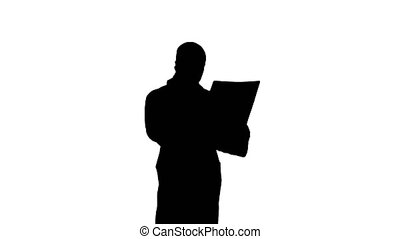 Silhouette Doctor holding Xray results and talking to the...