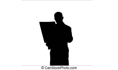 Silhouette Doctor examining Xray results