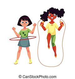 Two girls playing with jumping rope and hula hoop at...
