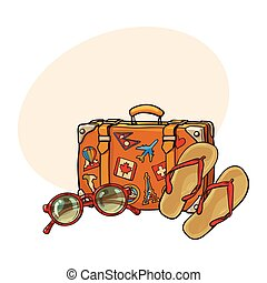 Flip flops, sunglasses, suitcase with tourist labels, beach...