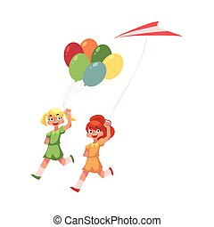 Two teenage girl friends running together with balloons and kite