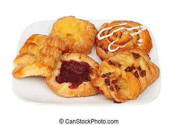 Danish pastries on a plate - Selection of Danish pastries on...