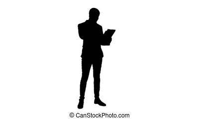 Silhouette Young businessman talking on cell phone and...