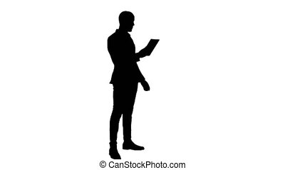 Silhouette Businessman making video call using tablet....