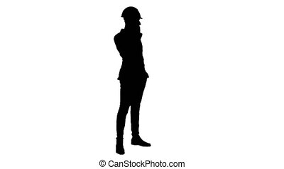 Silhouette Contractor in hardhat talking on mobile phone