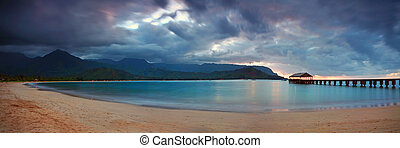 Hawaiian Pier at Sunset With Dramatic Clouds