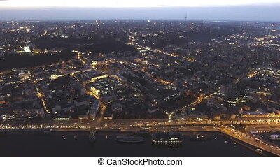 Aerial view of night city Kyiv, Ukraine, with car traffic. -...