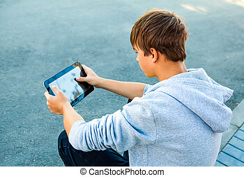 Teenager with Tablet Computer - Pensive Teenager with Tablet...