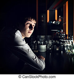 Young Man at the Bar - Toned Photo of Young Man Sit in the...
