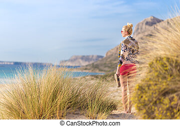Free Happy Woman Enjoying Sun on Vacations. - Relaxed woman...