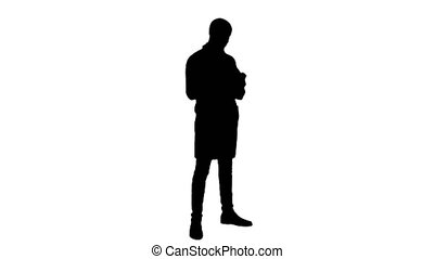 Silhouette Male doctor attentively reading label on a bottle...