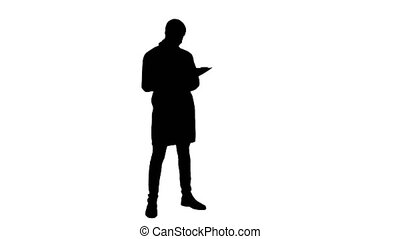 Silhouette Male doctor wearing white coat filling in patient...