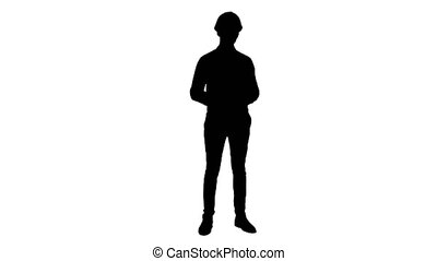 Silhouette Happy young engineer wearing helmet talking to...