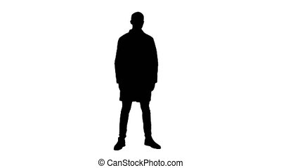 Silhouette Serious medical worker standing and folding his...