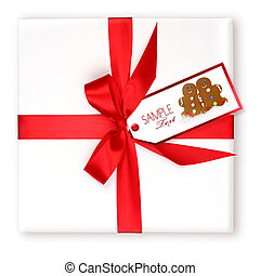 Pretty Wrapped Holiday Gift With Decorated Gift Tag