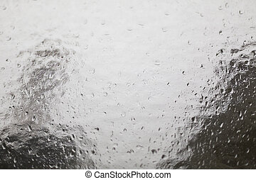 structural glass pane with rain drops