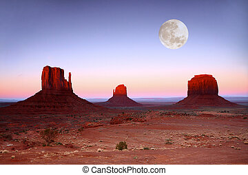 Sundown on the Buttes in Monument Valley Arizona - Moon Over...