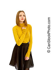 beautiful young girl in a yellow sweater and a black skirt -...