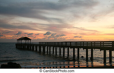 Hawaiian Pier at Sunset With Colorful Clouds