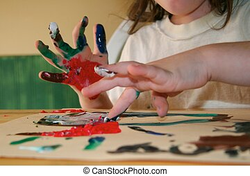 Child Finger Painting in Class on Paper - Preschool Child...