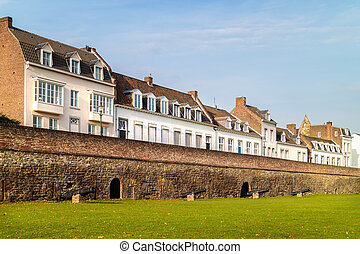 Ancient white houses in the Dutch city of Maastricht -...