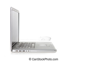 Sideways View of a Laptop Computer and Mouse on White...