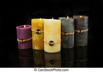 Feng Shui candles with reflections on black