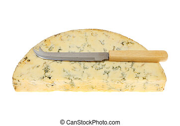 Half round of Stilton cheese with a cheese knife isolated...