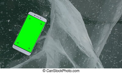 Smartphone on ice. - The smartphone rests on the beautiful...