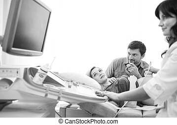 Monochrome shot of a loving pregnant couple at the hospital...