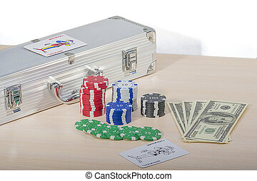 Casino chips and money - Multi-colored casino chips and...