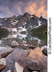 Morskie Oko lake in the Tatra Mountains, Poland at sunset -...