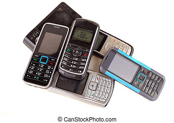 mobile phones - Heap of mobile phones isolated on white...