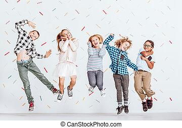 Happy kids jumping - Happy group of kids jumping in a room...