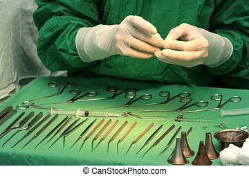 Preparing for surgery; detail with surgeon\'s hand