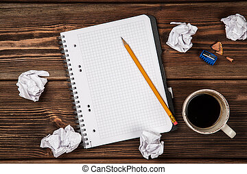 Creative block concept - blank notepad and crumpled paper