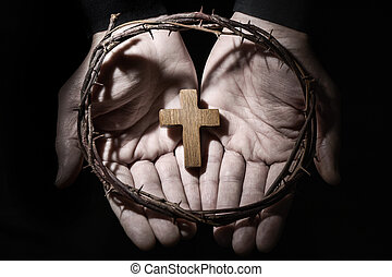 man with a cross and a crown of thorns