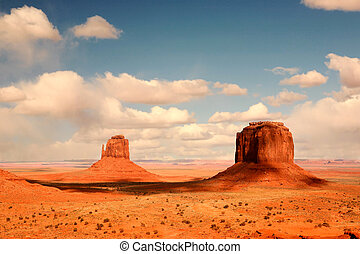 2 Buttes in Shadow in Monument Valley Arizona - Cloud...