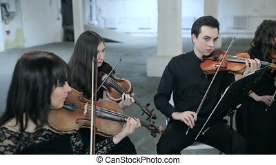 Violinists playing music in hall