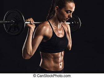 Working Hard - Shot of a beautiful young woman in a workout...