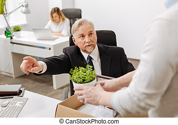 Aged bearded employer firing manager from the company