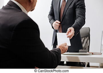 Confident employee giving the dismiss notice to the employer