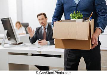 Fired senior employee leaving the office with the box -...