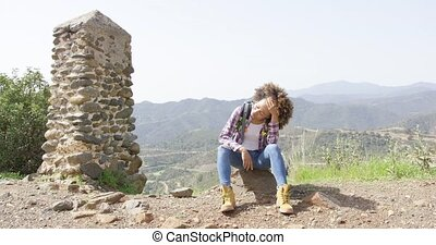 Smiling young woman on mountain - Young beautiful female...
