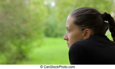 Close-up of a pensive girl with a dreamy look on the...