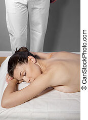 Therapy and relaxation, beautiful brunette woman relaxing on...