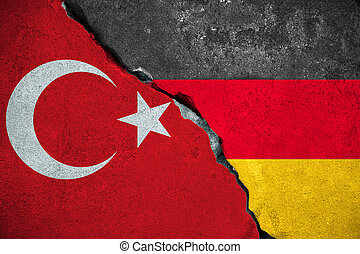 germany vs turkey, red turkey flag on broken damage brick...